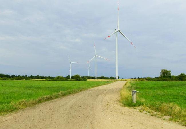 Pressebild: Direkt angetriebene Windenergieanlagen für vier deutsche Projekte: Siemens Gamesa installiert insgesamt 16 getriebelose Anlagen der Typen SWT-3.0-113, SWT-3.2-113 und SWT-3.6-130 bei vier Onshore-Projekten in Norddeutschland.