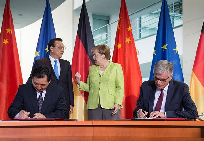 Pressebiuld: Lu Chun, Li Keqiang, Angela Merkel, Hubert Lienhard