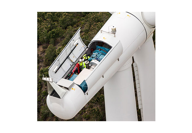 Siemens wind service technicians performing service and maintenance on a SWT-2.3 megawatt turbine.